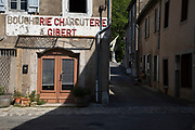 Scene of the old butchers shop in the medieval village of Lagrasse, Languedoc-Roussillon, France. Lagrasse is known as one of the most beautiful French villages. It lies in the valley of the River Orbieu and is famous for its stone bridge and The Abbey of St. Mary of Lagrasse, Abbaye Sainte-Marie de Lagrasse, a Romanesque Benedictine abbey.