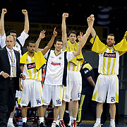 Fenerbahce Ulker's players (Left to Right) Lynn Terence GREER, Can Maxsim MUITAF, Gasper VIDMAR, Oguz SAVAS celebrate victory during their Turkish Basketball league semi final second leg match Fenerbahce Ulker between Banvit at Abdi Ipekci Arena in Istanbul, Turkey, Wednesday, May 12, 2010. Photo by TURKPIX