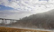 Salisbury Mills, New York -  Sunlight burns off the fog at the Moodna Viaduct railroad trestle by Schunnemunk Mountain on a warm winter day on Jan. 2, 2010.