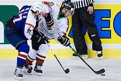 Hyon Ho Oh of Korea vs Daniel Fekete of Hungary at IIHF Ice-hockey World Championships Division I Group B match between National teams of Korea and Hungary, on April 17, 2010, in Tivoli hall, Ljubljana, Slovenia. Hungary defeated Korea 4-2. (Photo by Matic Klansek Velej / Sportida)