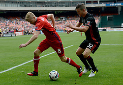 May 20, 2017 - Washington, DC, USA - 20170520 - Chicago Fire forward MICHAEL DE LEEUW (8) tries to work the ball past D.C. United defender BOBBY BOSWELL (32) in the first half at RFK Stadium in Washington. (Credit Image: © Chuck Myers via ZUMA Wire)