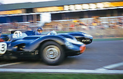 """Blurry photo of British Sports racing driver Bill de Selincourt (1921-2014)  nearest to camera driving Lister-Jaguar """" Knobbly"""" car  BARC event Goodwood, March 1961 start of race from grid"""