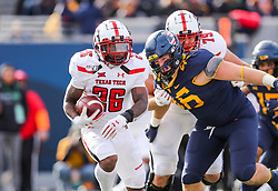 Nov 9, 2019; Morgantown, WV, USA; Texas Tech Red Raiders running back Ta'Zhawn Henry (26) runs the ball during the third quarter against the West Virginia Mountaineers at Mountaineer Field at Milan Puskar Stadium. Mandatory Credit: Ben Queen-USA TODAY Sports
