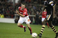 Photo: Pete Lorence.<br />Nottingham Forest v Charlton Athletic. The FA Cup. 06/01/2007.<br />Scott Dobie charges towards Djimi Traore.