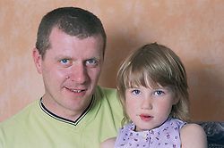 Portrait of father and daughter,
