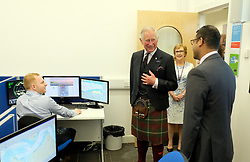 The Prince of Wales, known as the Duke of Rothesay while in Scotland, during a visit to the Scottish Maritime Academy, Peterhead, where he met staff and students who have just completed the 'Introduction to Seafishing' course.