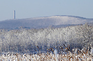 Greenville, NY - The High Point Monument in New Jersey is visible on a mountaintop in the background on the morning after a snowstorm on Dec. 6, 2009.