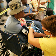Hurricane Katrina survivors receive medical attention while being evacuated from New Orleans.