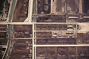 An aerial photograph of J.R. Simplot cattle feedlot near the J.R. Simplot potato processing plant in Idaho. The cattle are fattened on grain and potato waste from processing. J.R. Simplot Company is the largest supplier of French fries to McDonald's fast food company. USA.