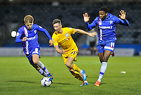 Preston North End's Alan Browne shields the ball from Gillingham's Jake Hessenthaler (left) and Antonio German (right)<br /> <br /> Photographer Ashley Western/CameraSport<br /> <br /> Football - The Football League Sky Bet League One - Gillingham v Preston North End - Tuesday 21st October 2014 - MEMS Priestfield Stadium - Gillingham<br /> <br /> © CameraSport - 43 Linden Ave. Countesthorpe. Leicester. England. LE8 5PG - Tel: +44 (0) 116 277 4147 - admin@camerasport.com - www.camerasport.com