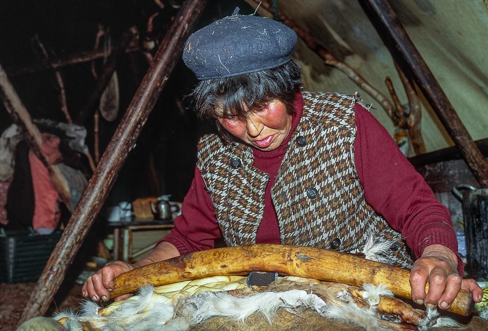 1 of 4, Olga Tinachvanau preparing reindeer hide for winter clothing, , Chukchi reindeer camp, Senyavina Strait, Chukotsk Peninsula, NE Russia, 1992