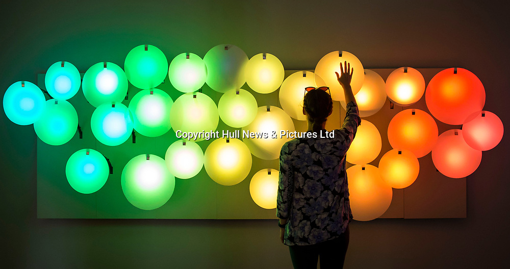 13 July 2017: A woman wafts her hand to light an art installation 'Colour Breeze' which has opened as part of the 'States of Play'  exhibition in Hull, East Yorkshire. 'Colour Breeze', by Katharina Mischer and Thomas Traxler, uses lighweight and fragile surfaces which react to breath or drafts, ulluminating when blown.<br /> 'States of Play' is part of Hull 2017 UK City of Culture and has a selection of contemporary work by UK and international artists.<br /> In an era of digital entertainment, it uses physical objects for play. <br /> It is supported by Arts Council England and British Council.<br /> It runs until 24 September at Humber Street Gallery.<br /> Picture: Sean Spencer/Hull News & Pictures Ltd<br /> 01482 210267/07976 433960<br /> www.hullnews.co.uk         sean@hullnews.co.uk