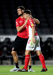 Charlton Athletic first team coach Johnnie Jackson with Albie Morgan after the final whistle