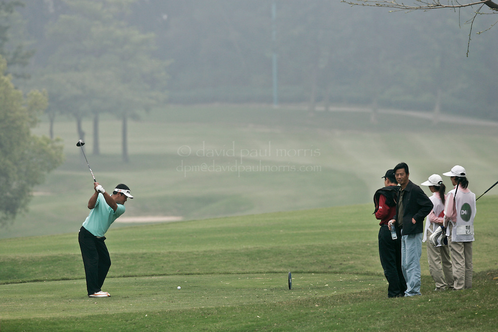XIAMEN, CHINA - MARCH 21:  Kong Weihai of China hits his drive on the 7th hole during 3rd round action of the Dell Championship at the Orient (Xiamen) Golf and Country Club on March 21, 2009 in Xiamen, China. A record number of entries of 132 players are competing for the RMB 1 million prize money.  (Photo by David  Paul Morris/ WSG)