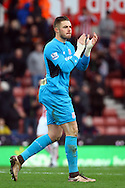 Stoke City Goalkeeper Jack Butland shows his appreciation to the home fans after the game. Barclays Premier league match, Stoke city v Manchester city at the Britannia Stadium in Stoke on Trent, Staffs on Saturday 5th December 2015.<br /> pic by Chris Stading, Andrew Orchard sports photography.