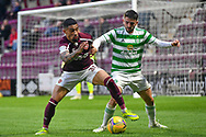 Josh Ginnelly (#30) of Heart of Midlothian FC and Greg Taylor (#3) of Celtic FC tussle for the ball during the Cinch SPFL Premiership match between Heart of Midlothian FC and Celtic FC at Tynecastle Park, Edinburgh, Scotland on 31 July 2021.
