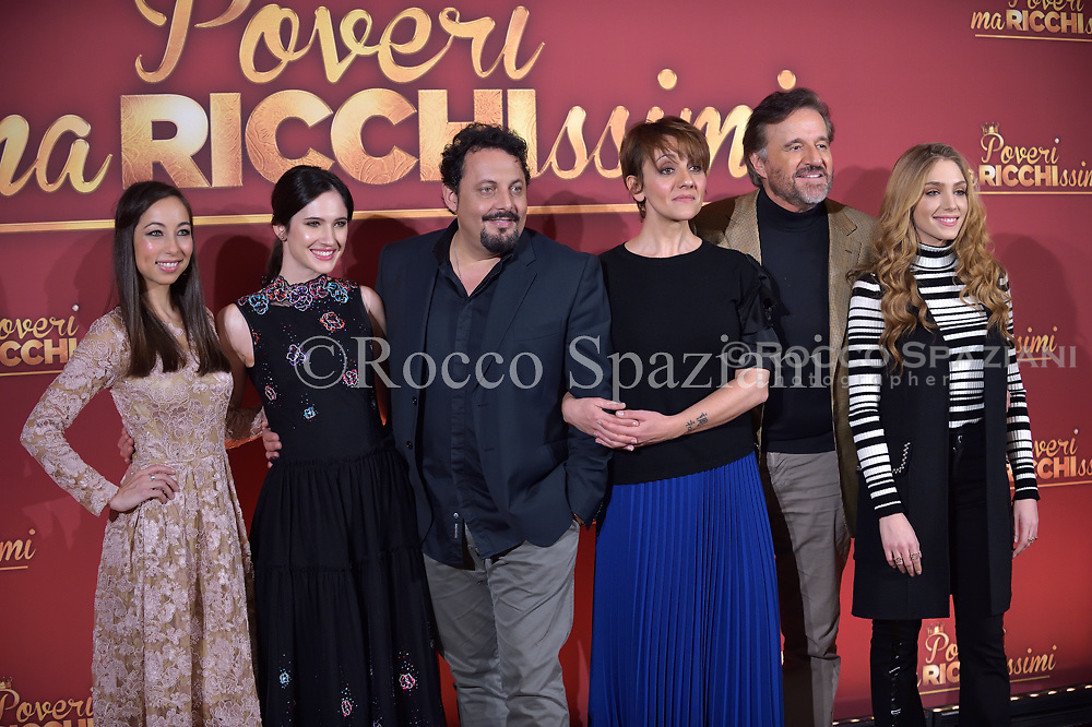 Tess Masazza, Lodovica Comello, Enrico Brignano, Lucia Ocon, Christia De Sica and Federica Lucaferri attend 'Poveri Ma Ricchissimi' photocall on December 11, 2017 in Rome, Italy.