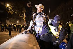 © Licensed to London News Pictures . 05/11/2016 . London , UK . Supporters of Anonymous , many wearing Guy Fawkes masks , attend the Million Mask March bonfire night demonstration , and clash with police on Whitehall in central London . Photo credit : Joel Goodman/LNP