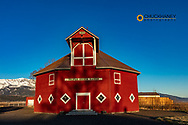 Triple Creek Ranch Octagonal Barn built in 1908 with Wallowa Mountains in Joseph, Oregon, USA