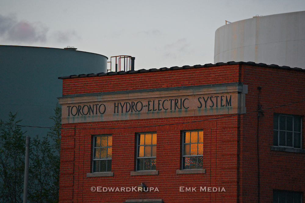 Toronto Hydro-Electric System building in the portlands area of Toronto in front of two gas storage tanks. Designated a heritage building in 2003.