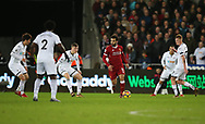 Mohamed Salah of Liverpool © is surrounded by Swansea city players as he looks to break through in midfield.  . Premier league match, Swansea city v Liverpool at the Liberty Stadium in Swansea, South Wales on Monday 22nd January 2018. <br /> pic by  Andrew Orchard, Andrew Orchard sports photography.