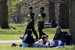 © Licensed to London News Pictures. 17/04/2021. London, UK. Police patrol as members of the public relax and enjoy the sunny weather in Hyde Park in central London. Temperatures are expected to rise with highs of 16 degrees forecasted for parts of London and South East England later this week . Photo credit: George Cracknell Wright/LNP