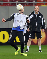 Chelsea's defender John Terry controls the ball as he takes part in a training session on March 6, 2013 at the National Arena Stadium one day before the UEFA Europa League football match against Steaua Bucharest.