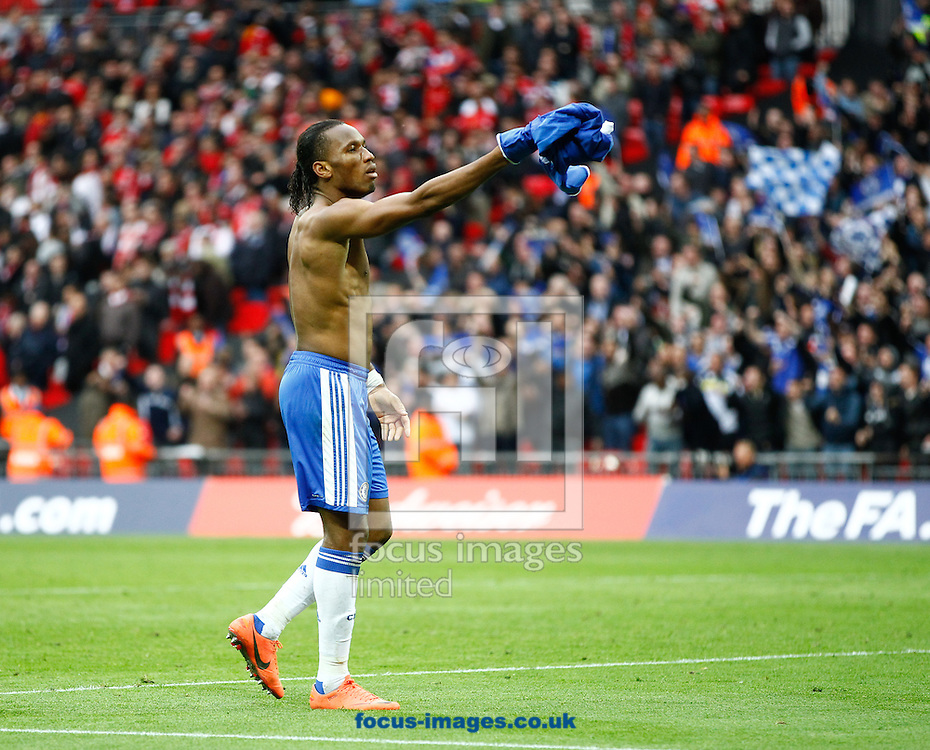 Picture by Andrew Tobin/Focus Images Ltd. 07710 761829. 5/5/12. Didier Drogba of Chelsea salutes the crowd after winning 2-1 during the FA Cup Final between Chelsea and Liverpool at Wembley Stadium, London