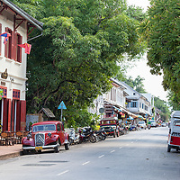 """The """"3 Nagas"""" Hotel with its red Citroen from 1952, parked outside in Luang Prabang."""