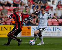 Photo: Leigh Quinnell.<br /> AFC Bournemouth v Swansea City. Coca Cola League 1. 14/04/2007. Swanseas Darryl Duffy turns away from Bournemouths Neil Young.