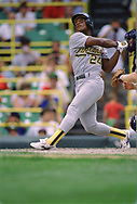 CHICAGO - 1989: Rickey Henderson of the Oakland Athletics bats during an MLB game versus the Chicago White Sox at Comiskey Park in Chicago, Illinois.  (Photo by Ron Vesely) Subject:   Ricky Henderson