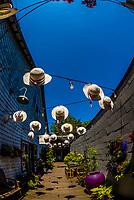 A display of hats at a shop on Winslow Way, Winslow, Bainbridge Island, Puget Sound (near Seattle), Washington USA.