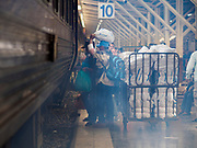 02 JANUARY 2019 - BANGKOK, THAILAND:      People in Hua Lamphong Train Station in Bangkok board a train bound for Trang, in southern Thailand. The train and bus stations in Bangkok were crowded Wednesday with people going home after the long New Year's weekend.       PHOTO BY JACK KURTZ