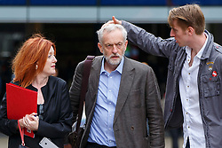 © Licensed to London News Pictures. London, UK. Labour Party leader candidate JEREMY CORBYN being prepared with help from his staff CARMEL NOLAN (left) and SEB CORBY (right),  before outlining his plans for integrated publicly owned railway network outside King's Cross station in London on Tuesday, August 18, 2015. Former Stop The War Coalition press officer CARMEL NOLAN has joined Jeremy Corbyn's team as a media advisorPhoto credit: Tolga Akmen/LNP