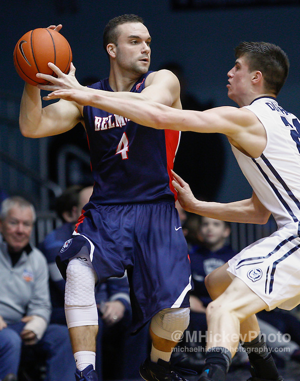 INDIANAPOLIS, IN - DECEMBER 28: Holden Mobley #4 of the Belmont Bruins holds the ball against Kellen Dunham #24 of the Butler Bulldogs at Hinkle Fieldhouse on December 28, 2014 in Indianapolis, Indiana. (Photo by Michael Hickey/Getty Images) *** Local Caption *** Holden Mobley; Kellen Dunham