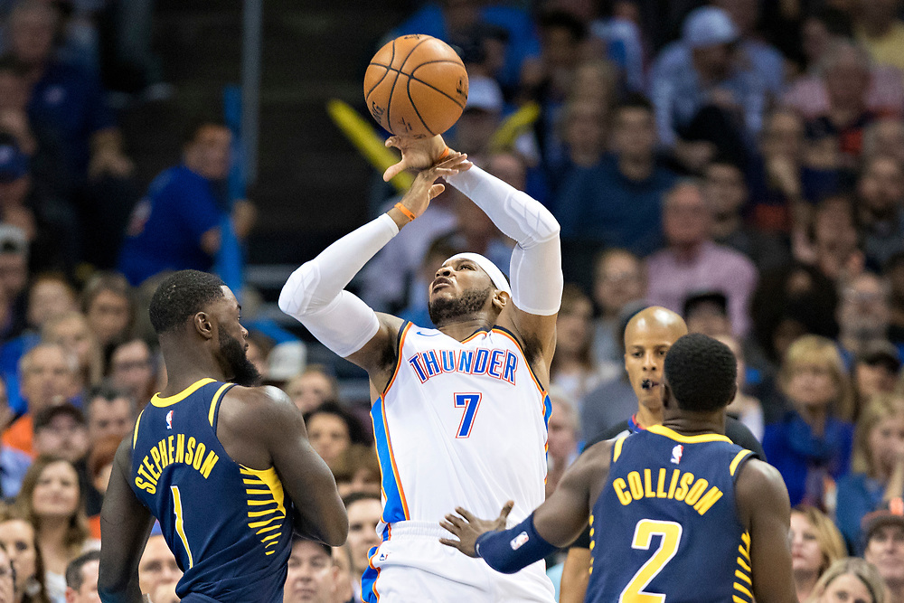 OKLAHOMA CITY, OK - OCTOBER 25:  Carmelo Anthony #7 of the Oklahoma City Thunder has the ball knocked away by Lance Stephenson #1 and Darren Collison #2 of the Indiana Pacers at the Chesapeake Energy Arena on October 25, 2017 in Oklahoma City, Oklahoma.  NOTE TO USER: User expressly acknowledges and agrees that, by downloading and or using this photograph, User is consenting to the terms and conditions of the Getty Images License Agreement.  The Thunder defeated the Pacers 114-96.  (Photo by Wesley Hitt/Getty Images) *** Local Caption *** Carmelo Anthony; Darren Collison; Lance Stephenson