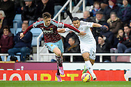 Carl Jenkinson of West Ham United competes with Jefferson Montero of Swansea City. Barclays Premier league match, West Ham Utd v Swansea city at the Boleyn ground, Upton Park in London on Sunday 7th December 2014.<br /> pic by John Patrick Fletcher, Andrew Orchard sports photography.