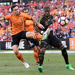 BRISBANE, AUSTRALIA - APRIL 16: Roly Bonevacia of the Phoenix and Tommy Oar of the Roar compete for the ball during the round 27 Hyundai A-League match between the Brisbane Roar and Wellington Phoenix at Suncorp Stadium on April 16, 2017 in Brisbane, Australia. (Photo by Patrick Kearney/Brisbane Roar)