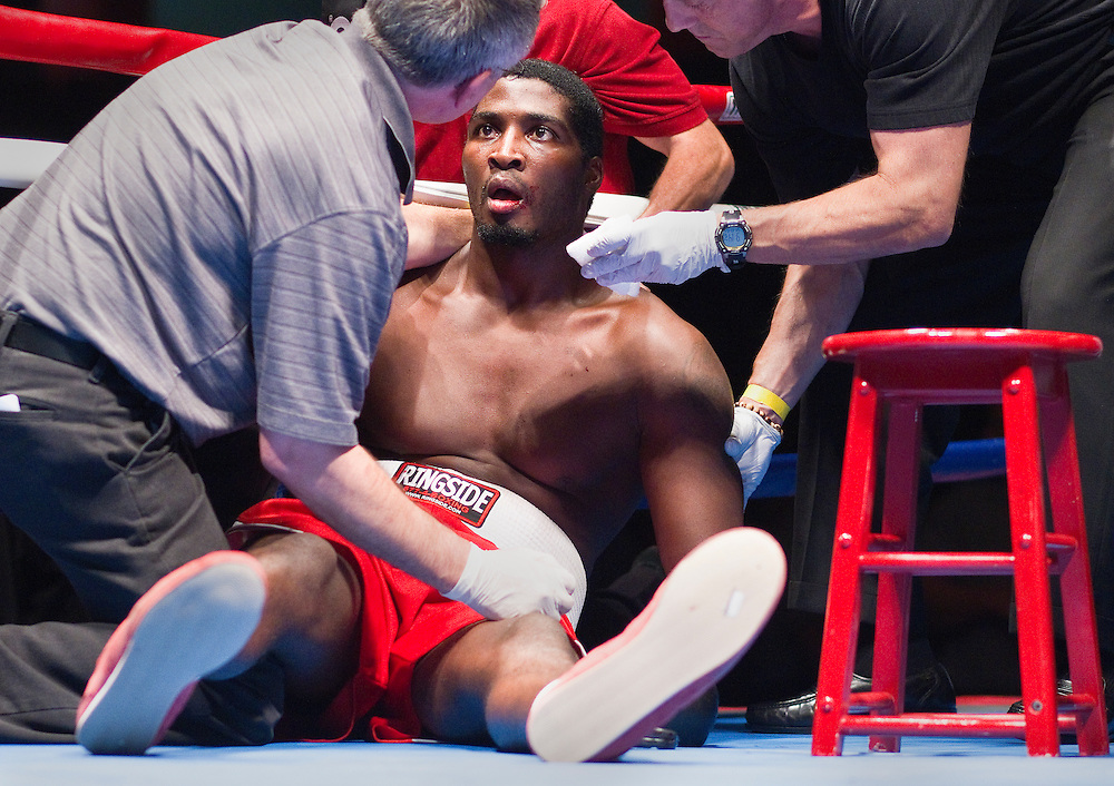 Tay Bledsoe looks wide-eyed while being attend to by medical staff after getting knocked out after 1:52 in the first round of Saturday's fight against Kimbo Slice at Heartland Events Center. (Independent/Matt Dixon)