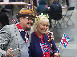 Trafalgar Square, London, June 12th 2016. Rain greets Londoners and visitors to the capital's Trafalgar Square as the Mayor hosts a Patron's Lunch in celebration of The Queen's 90th birthday. PICTURED: A couple wander through Trafalgar Square, enjoying the festive atmosphere despite the drizzle.