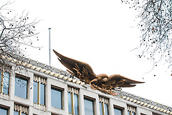 © Licensed to London News Pictures. 12/01/2018. London, UK. The Golden Eagle on top of the old US Embassy in Grosvenor Square, London, without the US flag which usually stands behind it. President of the United States Donald Trump has tweeted that he will no longer be visiting the UK to open the new embassy in Nine Elms, South London. Photo credit: Rob Pinney/LNP