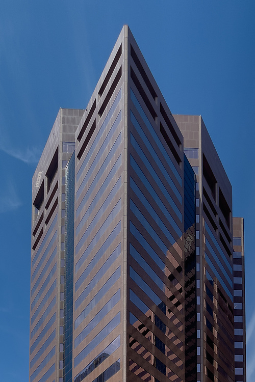 Reflections on a  building in downtown Phoenix make an abstract image.