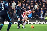 Eric Pieters of Stoke City shields the ball from Kevin De Bruyne of Manchester City. Barclays Premier league match, Stoke city v Manchester city at the Britannia Stadium in Stoke on Trent, Staffs on Saturday 5th December 2015.<br /> pic by Chris Stading, Andrew Orchard sports photography.
