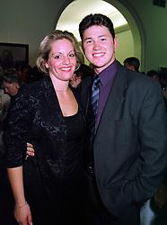 MISS ELIZABETH MAJOR daughter of former Prime Minister John Major and her fiance MR LUKE SALTER, at a party in London on 11th October 1999.MXK 7