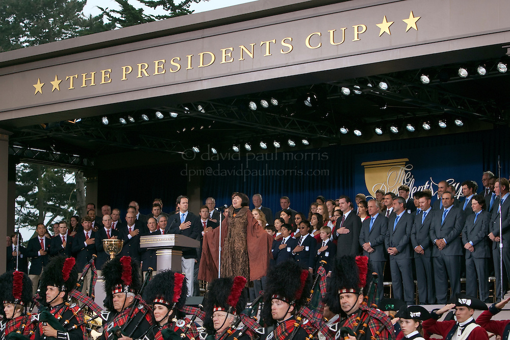 San Francisco Opera singer Zheng Cao sings the star spangled banner during opening ceremonies of the 2009 Presidents Cup at Harding Park Golf Course October 7, 2009 in San Francisco, California.  Photograph by David Paul Morris