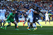 Darren Bent of Derby County (r)  looks to shoot while being held by Tommy Smith of Huddersfield Town. Skybet football league championship match, Huddersfield Town v Derby county at the John Smith's stadium in Huddersfield, Yorkshire on Saturday 18th April 2015.<br /> pic by Chris Stading, Andrew Orchard sports photography.