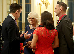 Embargoed to 0001 Saturday December 23 The Duchess of Cornwall, President of the National Osteoporosis Society, talks to 'Strictly Come Dancing' dancer Anton du Beke (left) with judges Shirley Ballas and Craig Revel Horwood as she hosts a tea dance at Buckingham Palace in London attended by 'Strictly Come Dancing' dancers and judges to highlight the benefits for older people of staying active.