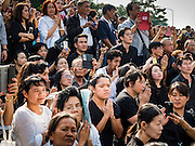 16 DECEMBER 2015 - BANGKOK, THAILAND: People pray during the funeral for Somdet Phra Nyanasamvara, Thailand's Supreme Patriarch, during the Patriarch's funeral. He died Oct. 24, 2013. He was ordained as a Buddhist monk in 1933 and appointed as the Supreme Patriarch in 1989. He was the spiritual advisor to Bhumibol Adulyadej, the King of Thailand when the King served as a monk in 1956. Tens of thousands of people lined the streets during the procession to pray for the Patriarch.     PHOTO BY JACK KURTZ