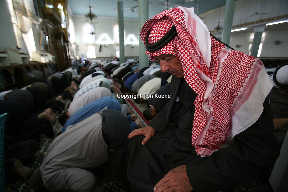 muslims pray in a mosque in Amman, Jordan