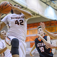 Gallup Bengal Troy Etsitty (42) pulls a rebound away from the Aztec Tigers defense Friday at Gallup High School.